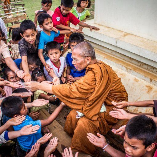 monk and children